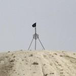 Bendera ISIS di perbatasan Suriah-Turki (Foto: REUTERS/Stringer/Files)