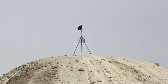 Bendera ISIS di perbatasan Suriah-Turki (Foto: REUTERS/Stringer/Files)